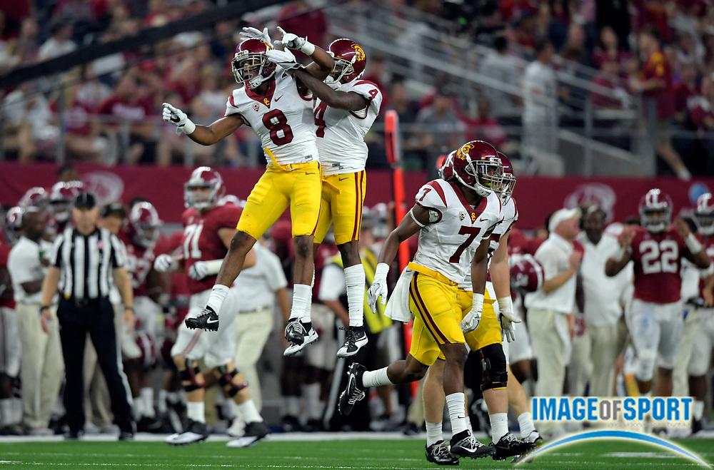 Sep 3, 2016; Arlington, TX, USA; USC Trojans defensive back Iman Marshall (8) celebrates with defensive back Chris Hawkins (4) during the third quarter against the Alabama Crimson Tide at AT&T Stadium.