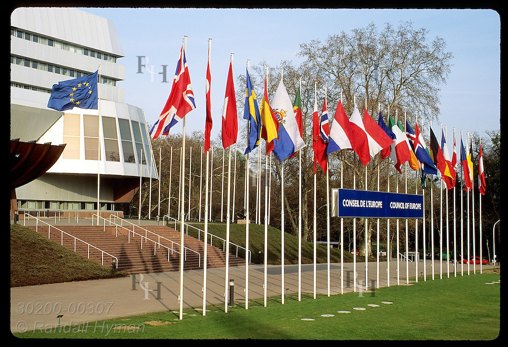 Flags of European nations & the EC line front of the Council of Europe headquarters; Strasbourg. France