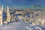Snowmobilers on the Big Mountain summit in Whitefish, Montana, USA