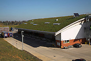 Sedum grass roofing and landscaped surroundings to blend in Adnams brewery distribution centre in a rural location at Reydon, near Southwold, Suffolk, England