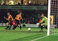 John Williams (Kidderminster) threads the ball between Lee Naylor and Mark Clyde (Wolves) to score Kidderminster's goal past the stranded Michael Oakes. Kidderminster v Wolverhampton Wanderers. FA Cup 3th rd. 3/1/2004. Credit : Colorsport/Andrew Cowie.