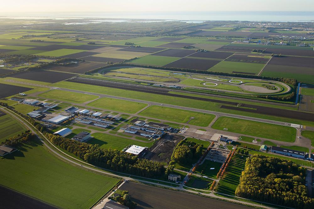 Nederland, Flevoland, Lelystad, 24-10-2013. Vliegveld Lelystad Airport met naast de start- en landingsbaan de testbaan van de Rijksdienst voor het Wegverkeer (RDW). Markermeer in de achtergrond.<br /> Lelystad Airport in the polder in between the farmland of the province Flevoland.<br /> luchtfoto (toeslag op standaard tarieven);<br /> aerial photo (additional fee required);<br /> copyright foto/photo Siebe Swart.