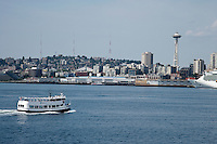 Seattle waterfront and Space Needle and a water taxi on Puget Sound, WA, USA