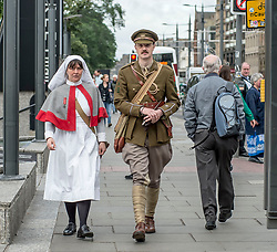 100 years to the day from when the celebrated Great War poet Wilfred Owen arrived for treatment in Edinburgh the ocassion was marked with a re-enactment of that arrival and the historic walk he made along Princes Street. Pictured is Wilfred Owen, played by David Clarke of the Scots in the Great War Living History Society, along with fellow actor in WW1 costume Ailsa Clarke.<br /> <br /> © Dave Johnston/ EEm