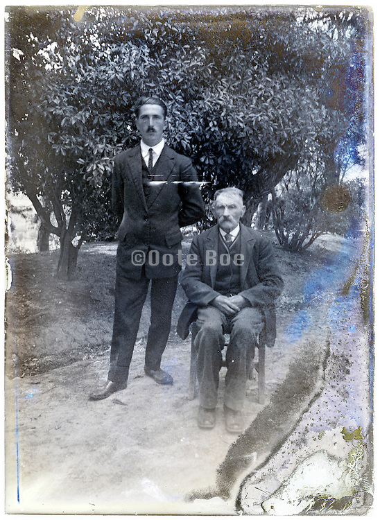 portrait of father with son on a eroding glass plate