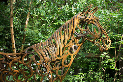 The World Horse Welfare Garden, overgrown paddock with horse sculpture made of horseshoes. Design: Adam Woolcott and Jonathan Smith, Built by: Conway Landscapes, Sponsored by: World Horse Welfare