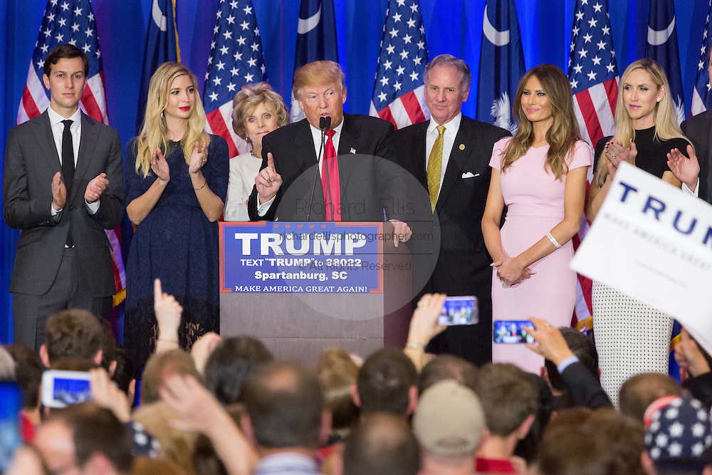 Billionaire and GOP presidential candidate Donald Trump addresses supporters alongside his family and Lt. Gov. Henry McMasters as they celebrate victory in the South Carolina Republican primary February 20, 2016 in Spartanburg, South Carolina, USA .