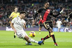 December 15, 2018 - Madrid, Spain - Real Madrid's MARCO ASENSIO and ABDOULAYE BA of Rayo Vallecano during Spanish La Liga action at Santiago Bernabeu Stadium. (Credit Image: © Coolmedia/NurPhoto via ZUMA Press)