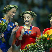 United States gymnast Carly Patterson, center, showed her gold medal to Russia's Svetlana Khorkina, left, on the medals ceremony stand with bronze medalist Nan Zhang of China at right. Patterson won the women's individual all-around final Thursday evening at the 2004 Summer Olympic Games in Athens, Greece.
