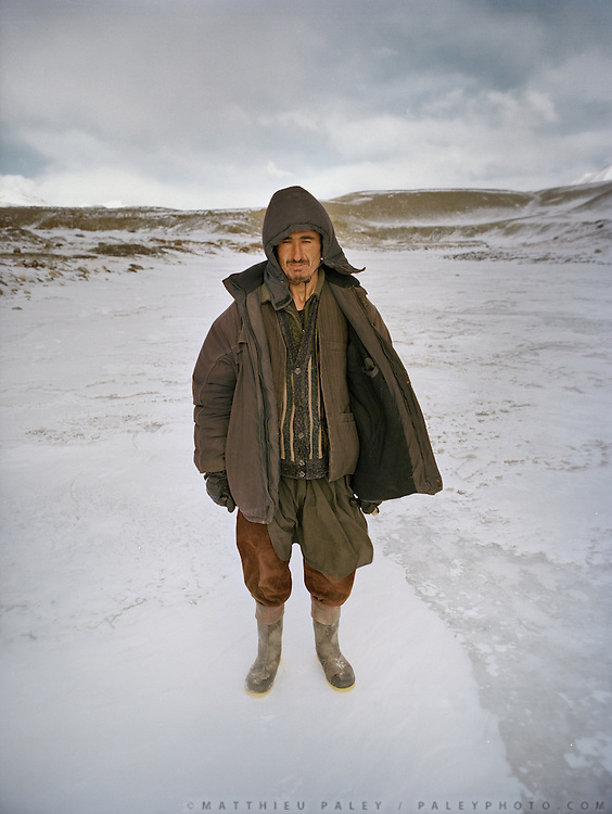 Poor Badakhshi man, opium dealer, met on the frozen river, on his way to selling drugs and other trinkets to the Kyrgyz..Trekking with Wakhi companion Malang down the frozen Wakhan River, the only way up and down to the Little Pamir..Winter expedition through the Wakhan Corridor and into the Afghan Pamir mountains, to document the life of the Afghan Kyrgyz tribe. January/February 2008. Afghanistan
