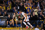Fans celebrate after Golden State Warriors guard Stephen Curry (30) scores a three pointer against the LA Clippers at Oracle Arena in Oakland, Calif., on January 28, 2017. (Stan Olszewski/Special to S.F. Examiner)