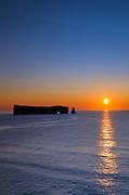 SUnrise and Rocher percé  (Percé Rock) on the Atlantic Ocean<br /> Percé <br /> Quebec<br /> Canada