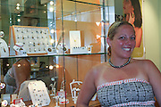 young woman wears a necklace of Tahitian pearl AKA Black Pearls Photographed in French Polynesia