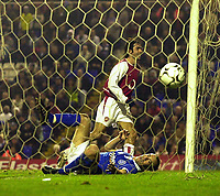 Photo. Glyn Thomas.<br /> Birmingham City v Arsenal. Barclaycard Premiership<br /> St Andrew's Stadium, Birmingham. 22/11/03.<br /> Arsenal's Robert Pires (T) wheels away in delight after scoring his side's third goal, while Matthew Upson looks on in disbelief.