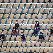 PARIS, FRANCE September 25. Ball boys and girls socially distance as they watch practice on Court Philippe-Chatrier at the 2020 French Open Tennis Tournament at Roland Garros on September 25th 2020 in Paris, France. (Photo by Tim Clayton/Corbis via Getty Images)