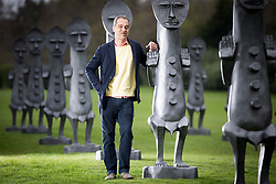 © Licensed to London News Pictures. 07/04/2017. Wakefield UK. Artist Zak Ove stands among the 80 identical 2 metre tall graphite figures he created called Black & Blue: The invisible Man & the Masque of Blackness that are now on show at Yorkshire Sculpture Park. Photo credit: Andrew McCaren/LNP