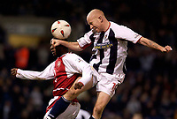 Photo. Jed Wee.<br /> West Bromwich Albion v Arsenal, Carling Cup, The Hawthorns, West Bromwich. 16/12/2003.<br /> West Brom's Lee Hughes (R) directs a header goalwards.