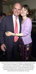 MR & MRS NICHOLAS COLERIDGE m/d of Conde Nast, at a  party in London on 23rd April 2002.OZG 15