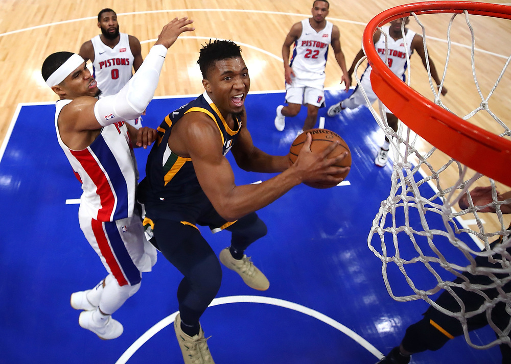 DETROIT, MI - JANUARY 24: Donovan Mitchell #45 of the Utah Jazz tries to get a shot off past Tobias Harris #34 of the Detroit Pistons during the first half at Little Caesars Arena on January 24, 2018 in Detroit, Michigan. Utah won the game 98-95 in overtime. NOTE TO USER: User expressly acknowledges and agrees that, by downloading and or using this photograph, User is consenting to the terms and conditions of the Getty Images License Agreement. (Photo by Gregory Shamus/Getty Images)