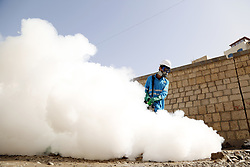 March 21, 2019 - Sanaa, Yemen - A worker sprays anti-cholera disinfectant on garbage during an anti-cholera campaign in Sanaa, Yemen. (Credit Image: © Nieyunpeng/Xinhua via ZUMA Wire)