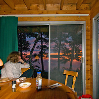 Meredith Wiltsie enjoys summer sunset from cabin on Lake of the Woods, Ontario, Canada.