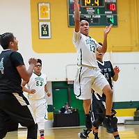 Guard Orin Chacho (13) of the Hawks drives to the basket uncontested on Friday night in Thoreau.