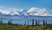 See the snowy Alaska Range from the Richardson Highway in Alaska, USA. Panorama stitched from 2 overlapping photos.