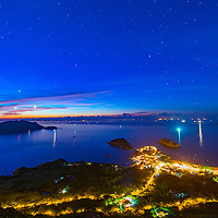 Starry night sky capture right before sun rise over the town of Shek O in Hong Kong, atop of the famous Dragon Back Ridge.