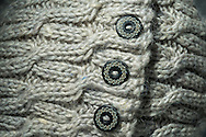 Close-up of a knitted hat and button decoration.