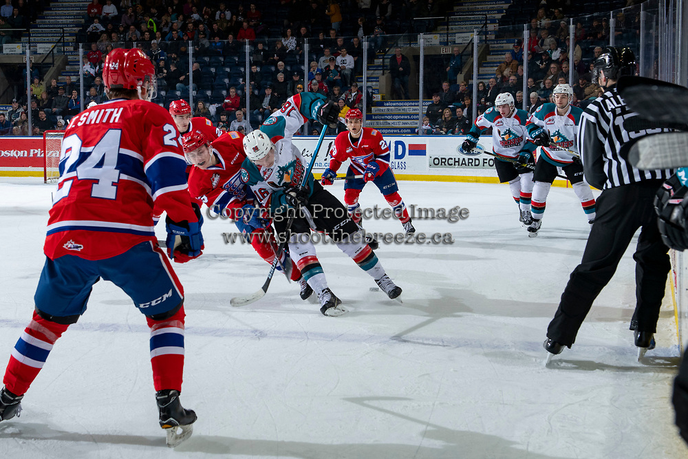 KELOWNA, CANADA - FEBRUARY 6:  Michael Farren #16 of the Kelowna Rockets is checked by Connor Gabruch #23 of the Spokane Chiefs on February 6, 2019 at Prospera Place in Kelowna, British Columbia, Canada.  (Photo by Marissa Baecker/Shoot the Breeze)