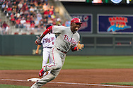 John Mayberry #15 of the Philadelphia Phillies sprints toward home against the Minnesota Twins on June 11, 2013 at Target Field in Minneapolis, Minnesota.  The Twins defeated the Phillies 3 to 2.  Photo: Ben Krause
