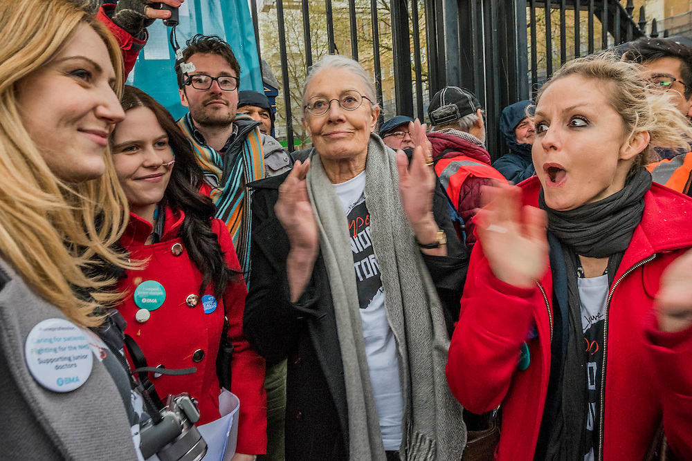 Vanessa Redgrave was one of the speakers, here with others (a patient on the left but both in red coats) - Doctors leave the picket line at St Thomas' Hospital to march to the DoH in Whitehall. Junior Doctors stage a 7 day all out strike action, this time imncluding accident and emergency coverage. They are striking against the new contracts due to be imposed by the Governemnt and health minister Jeremy Hunt. They are supported by the British Medical Association.