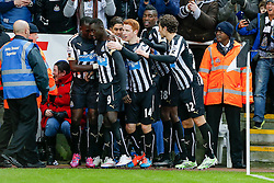 Papiss Demba Cisse of Newcastle United celebrates with his teammates after  scoring a goal to make it 1-0 - Photo mandatory by-line: Rogan Thomson/JMP - 07966 386802 -06/12/2014 - SPORT - FOOTBALL - Newcastle, England - St James' Park - Newcastle United v Chelsea - Barclays Premier League.