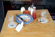 Dirty dishes following breakfast at a cafe in Brixham, Devon, United Kingdom on 25 July 2017