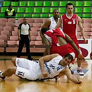 Efes Pilsen's Kaya PEKER (F) and Erdemir's Nate FUNK (B) during their Turkish Basketball league Play Off first leg match Efes Pilsen between Erdemir at the Ayhan Sahenk Arena in Istanbul Turkey on Thursday 29 April 2010. Photo by Aykut AKICI/TURKPIX