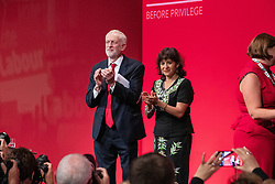 © Licensed to London News Pictures . 24/09/2019. Brighton, UK. Labour leader JEREMY CORBYN and his wife LAURA ALVAREZ wave from the stage after Corbyn delivers the leader's speech a day early , on the fourth day of the 2019 Labour Party Conference from the Brighton Centre , after the Supreme Court ruled that Boris Johnson's suspension of Parliament was unlawful . Photo credit: Joel Goodman/LNP