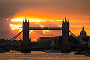 Sunset behind Tower Bridge on the River Thames in London, England following a day of stormy weather in the capital on August 13, 2018