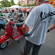 MILAN, ITALY - JUNE 05:  A Vespa enthusiast, at the Museo Scienza e Tecnica, admires some of the scooters ahead the Vespa race on June 5, 2010 in Milan, Italy. Vespa is one of the best known Italian icons, the special Vespa weekend is the XV edition of the famous  500km night race  (Photo by Marco Secchi/Getty Images)