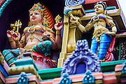 20 DECEMBER 2012 - KUALA LUMPUR, MALAYSIA: Deities above the entrance to the Sri Mahamariamman Temple in Kuala Lumpur. The Sri Mahamariamman Temple is the oldest and richest Hindu temple in Kuala Lumpur, Malaysia. Founded in 1873, it is situated at edge of Chinatown in Jalan Bandar (formerly High Street). In 1968, a new structure was built, featuring the ornate 'Raja Gopuram' tower in the style of South Indian temples. From its inception, the temple provided an important place of worship for early Indian immigrants and is now an important cultural and national heritage in Malaysia.   PHOTO BY JACK KURTZ