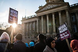 """© Licensed to London News Pictures . 26/11/2016 . Bolton , UK . Anti fascists outside Bolton Town Hall , pictured holding a counter demonstration . Approximately 100 people attend a demonstration against the construction of mosques in Bolton , under the banner """" No More Mosques """" , organised by a coalition of far-right organisations and approximately 150 anti fascists opposing the demonstration , in Victoria Square in Bolton Town Centre . Photo credit : Joel Goodman/LNP"""