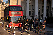 With the columns of Royal Exchange in the background, cyclists and a London bus are queued at a red light in at Bank Triangle and  in the City of London, the capital's financial district, on 27th February 2021, in London, England. (Photo by Richard Baker / In Pictures via Getty Images)