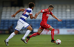 Swindon Town's Bradley Barry and Queens Park Rangers's James Perch in action