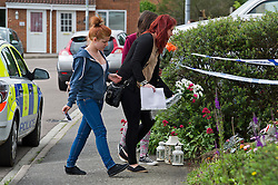 © London News Pictures. 10/06/2012.  Ampthill, UK. Friends of Megan-Leigh Peat, aged between 14 and 16, laying flowers outside the property where 15-year-old Megan died in the early hours of Saturday morning. Schoolgirl Megan-Leigh Peat was stabbed to death at a house party thrown by a boy whose parents are away on holiday. Photo credit: Ben Cawthra/LNP