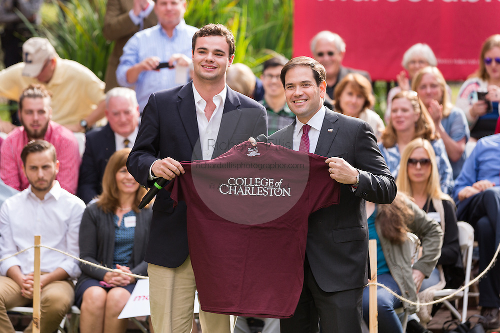 Senator and GOP presidential candidate Marco Rubio accepts a college shirt from student leader Ken Hansell after speaking to students at the Bully Pulpit series town hall at the College of Charleston December 1, 2015 in Charleston, South Carolina.