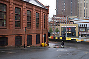 UCKG Help Centre church in Birmingham city centre, which is virtually deserted under Coronavirus lockdown on a wet rainy afternoon on 28th April 2020 in Birmingham, England, United Kingdom. Britains second city has been in a state of redevelopment for some years now, but with many outdated architectural remnants still remaining, on a grey day, the urban landscape appears as if frozen in time. Coronavirus or Covid-19 is a new respiratory illness that has not previously been seen in humans. While much or Europe has been placed into lockdown, the UK government has put in place more stringent rules as part of their long term strategy, and in particular social distancing.