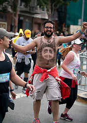 A man literally wearing a hair shirt mugs for the camera at the 107th running of the Bay to Breakers, Sunday, May 20, 2018, in San Francisco. (Photo by D. Ross Cameron)