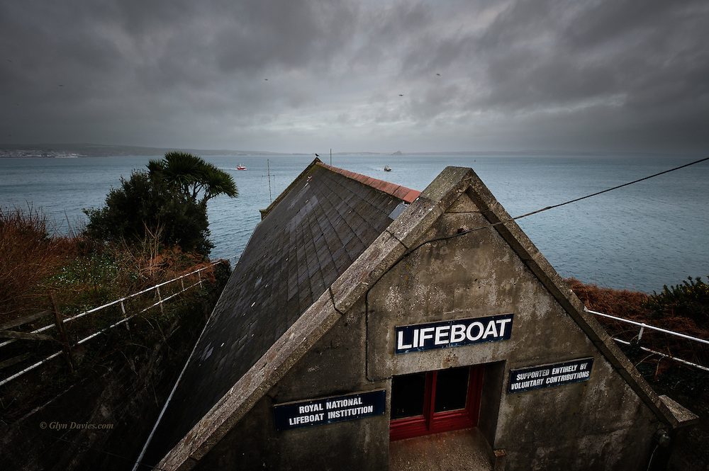 It's impossible for me to walk past the old now abandoned lifeboat house at Penlee, Mousehole without stopping to remember, with great sadness the loss of so many brave, amazing men from one small community. <br /> <br /> The Penlee lifeboat disaster occurred on 19 December 1981 off the coast of Cornwall. The RNLB Solomon Browne went to the aid of the vessel Union Star after its engines failed in heavy seas. After the lifeboat had rescued four people, both vessels were lost with all hands; in all, sixteen people died including eight volunteer lifeboatmen. (From Wiki)<br /> <br /> I was living in Falmouth at the time and the shock across Cornwall and indeed Britain was deep and heartfelt. In school we had assemblies to talk about what had happened to these brave volunteers who risked and lost their own lives to save others. Our communities all felt deep sympathy for the families shattered by the loss of these men. <br /> <br /> To stand above this lifeboat house which was abandoned just two years after the disaster is a direct flashback to that shocking time in my childhood.