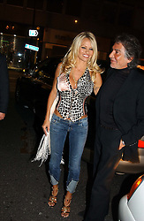 PAMELA ANDERSON and ROBERTO CAVALLI<br /><br />at the 33rd birthday party of Jade Jagger, held at Garrard, 8 Grafton Street, London W1 on 21st October 2004.<br /><br /><br /><br />NON EXCLUSIVE - WORLD RIGHTS