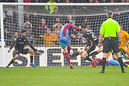 Matthew Lund of Scunthorpe United (7) shot is blocked by Paudie O'Connor of Bradford City (5) during the EFL Sky Bet League 1 match between Scunthorpe United and Bradford City at Glanford Park, Scunthorpe, England on 27 April 2019.