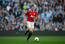 MANCHESTER, ENGLAND - Monday, April 30, 2012: Manchester United's Michael Carrick in action against Manchester City during the Premiership match at the City of Manchester Stadium. (Pic by David Rawcliffe/Propaganda)